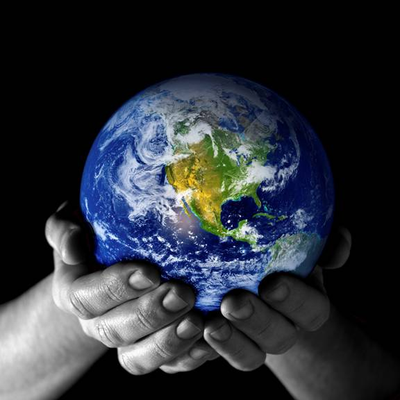 Image of earth held by hands.