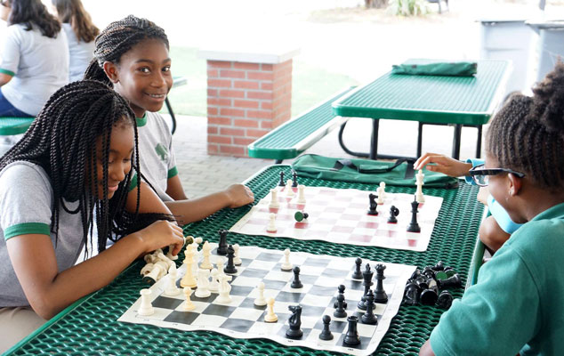 Girls playing chess.